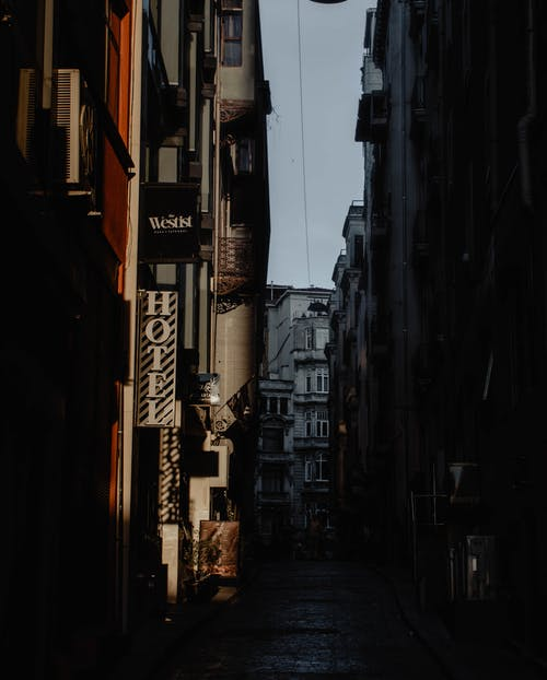 Empty street amidst aged buildings at dawn