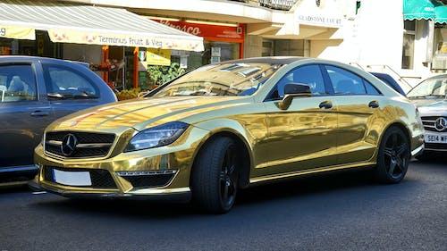 Gold Mercedes-benz Sedan on Road