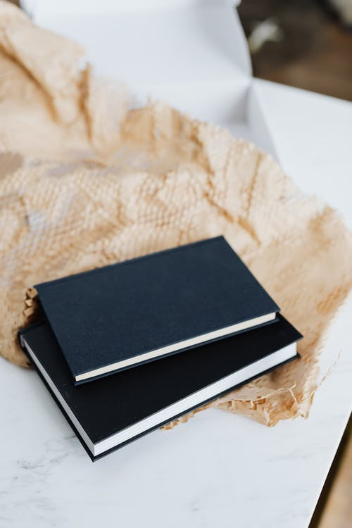 Black notebooks and packing stuff
