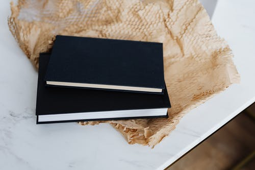 Closed black notebooks and packing material