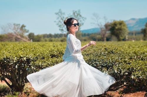 Young woman having fun in field