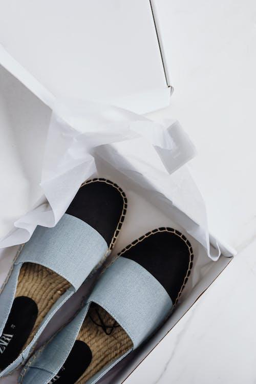 Stylish espadrilles shoes in carton box