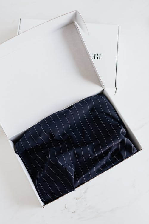 Luxury silk garment in carton package