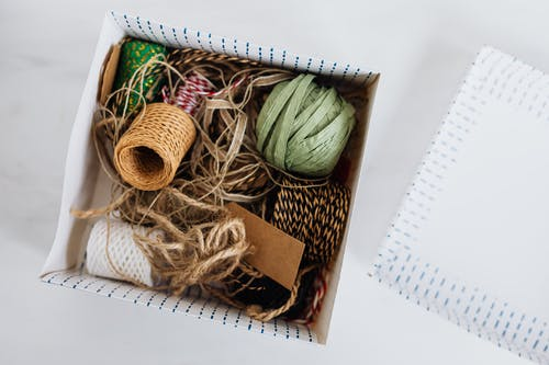 Various ribbons and ropes for packages wrapping in box