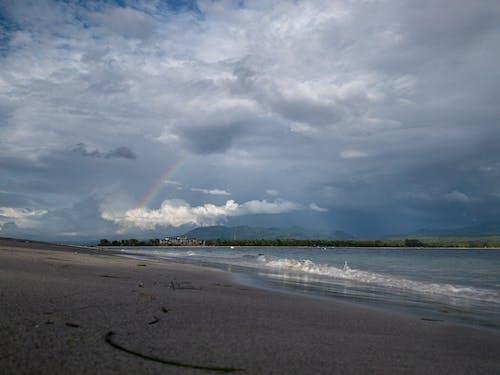 Free stock photo of beach sunset, blue ocean, dark sky