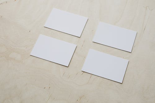 Clean white visiting cards on wooden surface