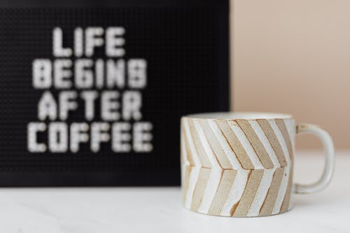 Cup of coffee and peg message board with funny title