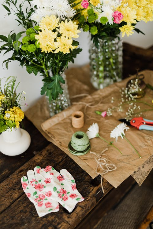 Bouquets and floristry tools on wooden bench