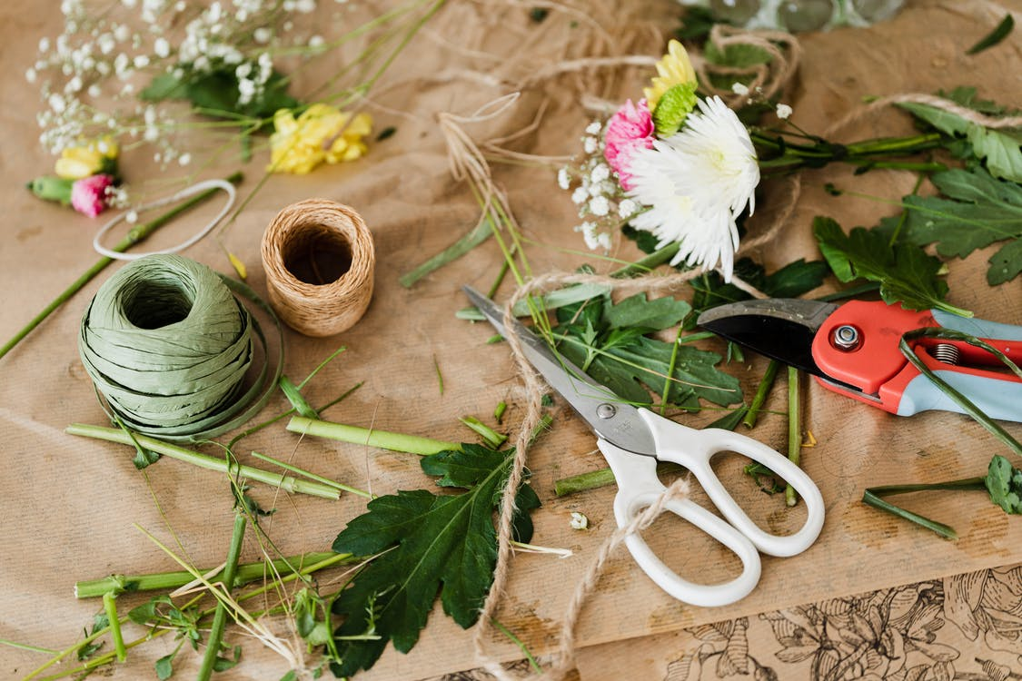 Pruners and scissors together with twine in florist shop