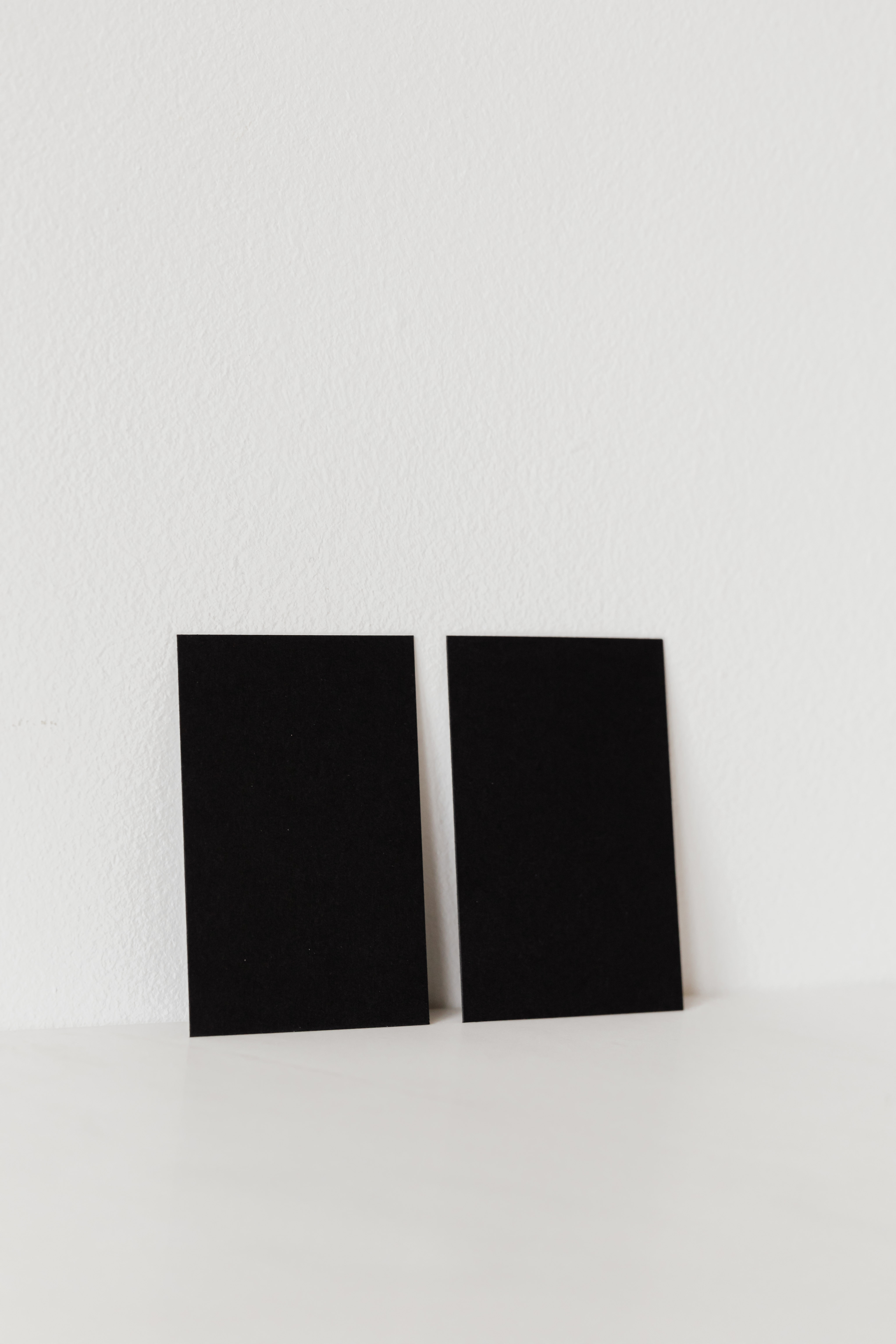 black mockup visiting cards on white background