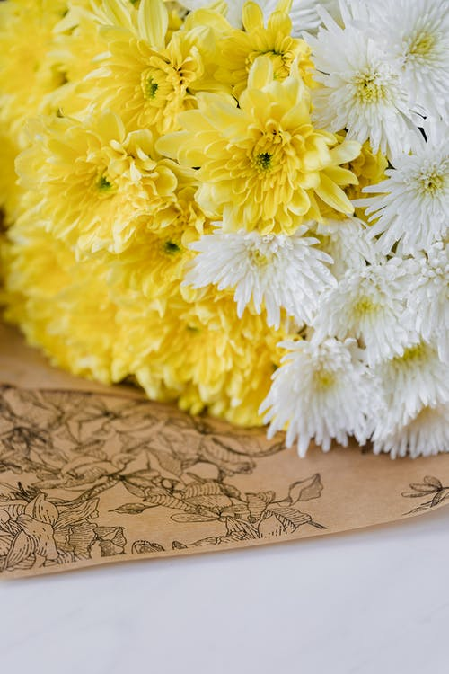 Fresh bouquet of flowers on table