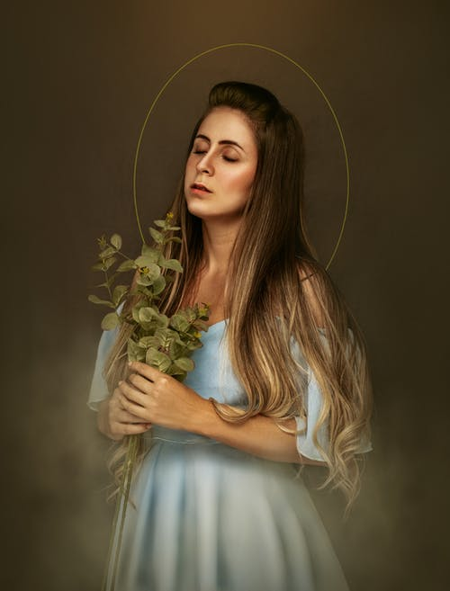 Saint woman with plant twigs