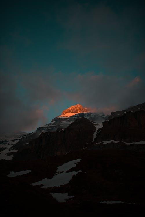 Snowy mountain range in evening