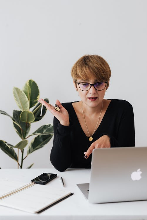 Serious businesswoman having video call via laptop