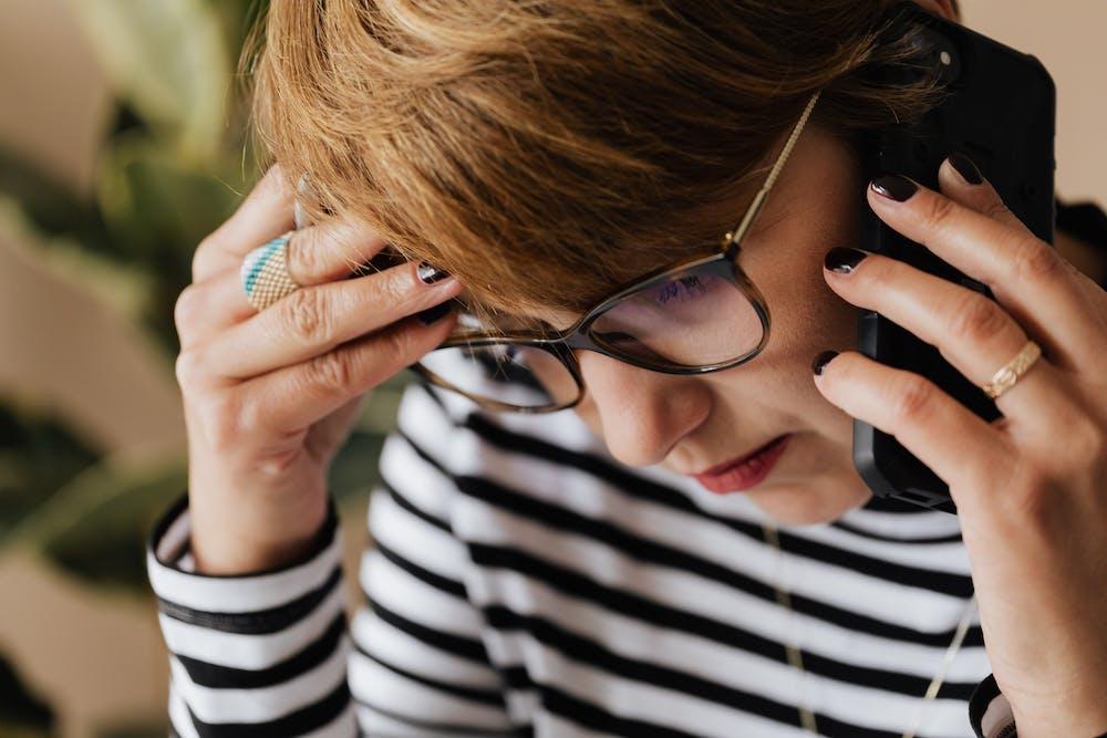 Woman having a phone conversation.   Photo: Pexels