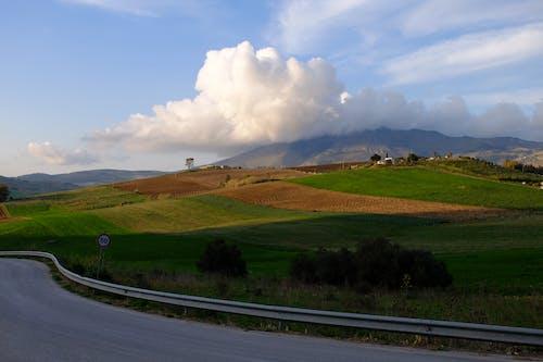 Безкоштовне стокове фото на тему «дорога, поле, хмара»