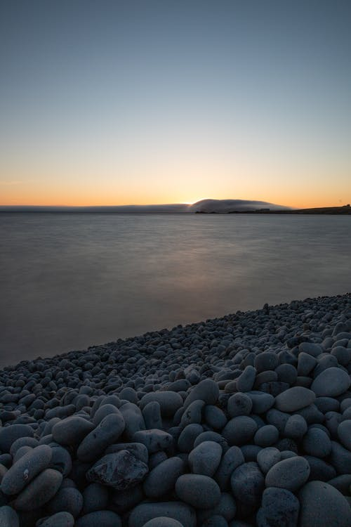 Darmowe zdjęcie z galerii z islandia, kamienie, zachód słońca