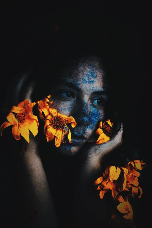 Woman With Yellow Flower on Her Face