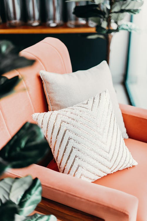 White Throw Pillow on Brown Leather Couch