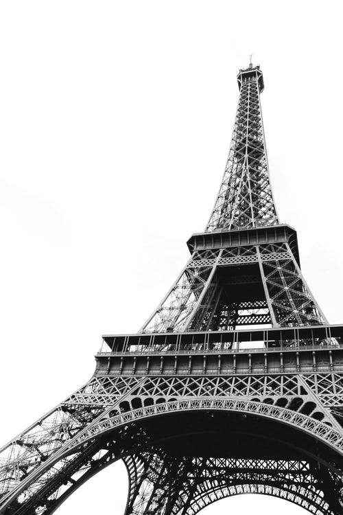 From below of metal tower in center of Paris most recognizable architectural landmark Eiffel Tower