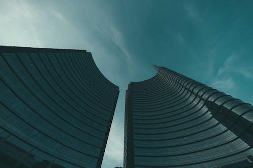 Black High Rise Building Under Blue Sky