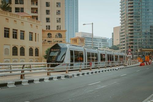 Modern public transport among high buildings