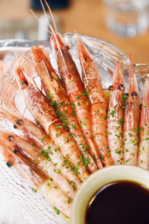 Close-Up Photo of Cooked Shrimps on Clear Glass Bowl