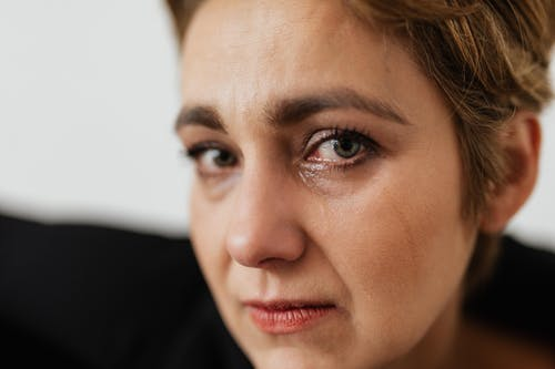 Close-Up Photo of Person Crying