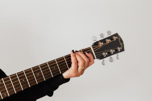 Person Holding Black and Brown Acoustic Guitar