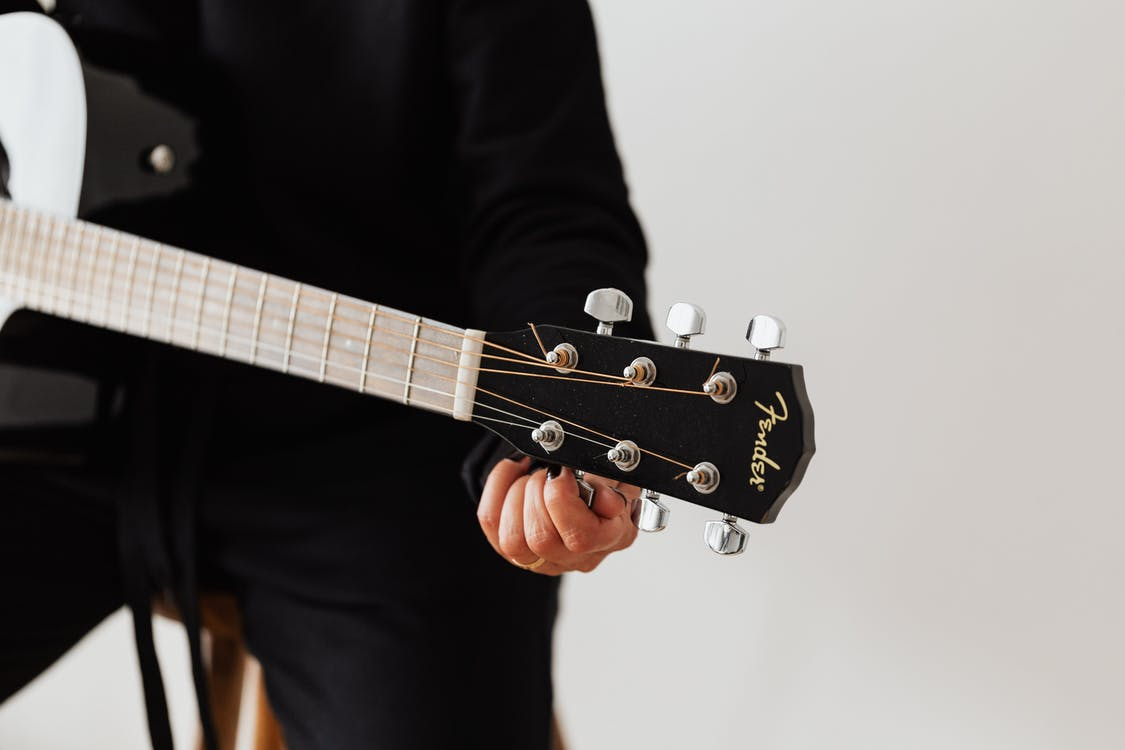 Person Holding Tuning Pegs
