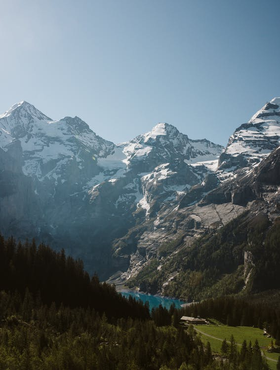 Mountain peaks with lake and green forest