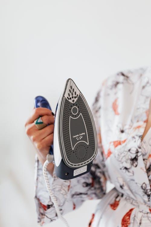 A Person Holding a Clothes Iron