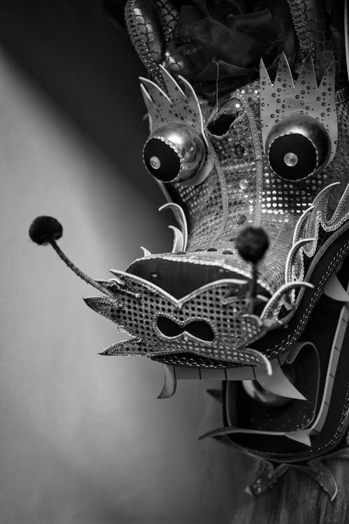 Black and white decorative statue of traditional Chinese dragon made for local festival