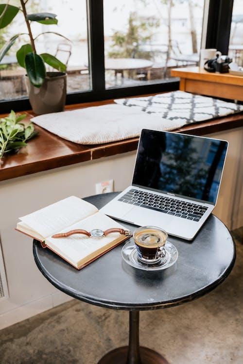 Macbook Pro on Black Round Table