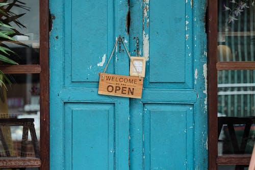 Wooden Welcome Signage on Doorknob