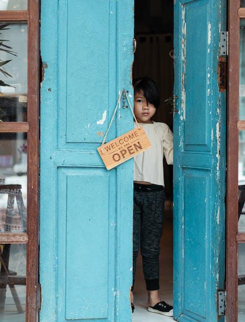 Photo of Girl Standing on Doorway