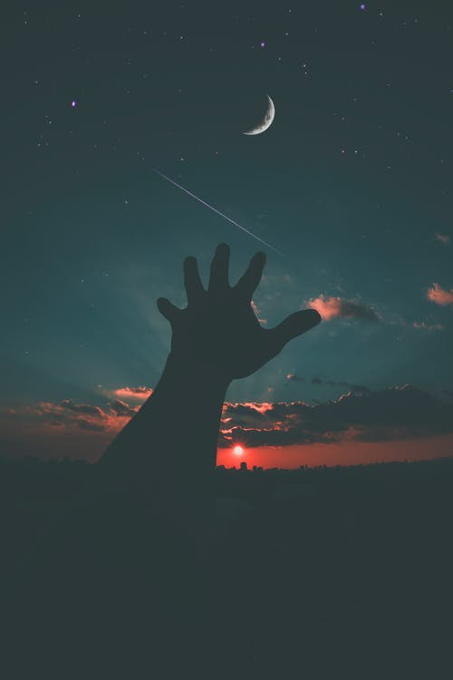 Person Hand and Crescent Moon