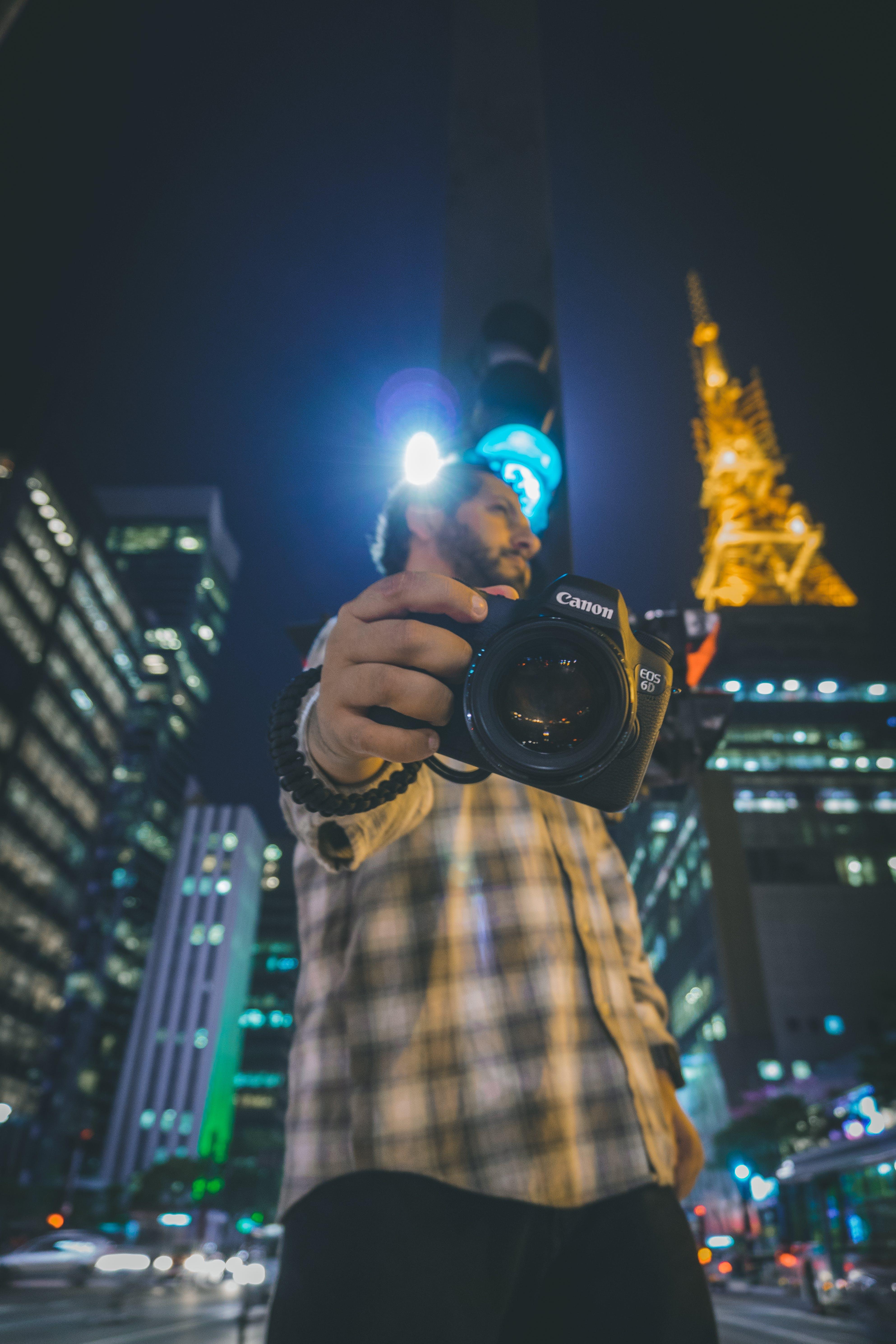 Man Holding Canon Dlsr Camera
