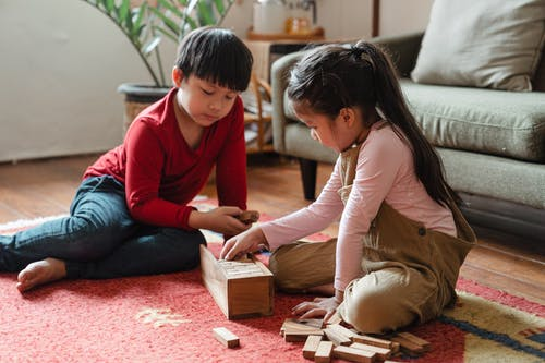 Photo of Kids Playing With Wooden Blocks