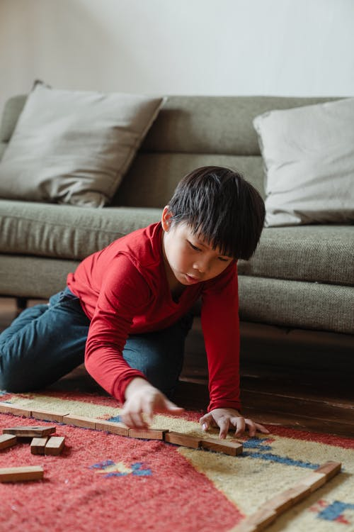 Photo of Boy Playing With Wooden Blocks
