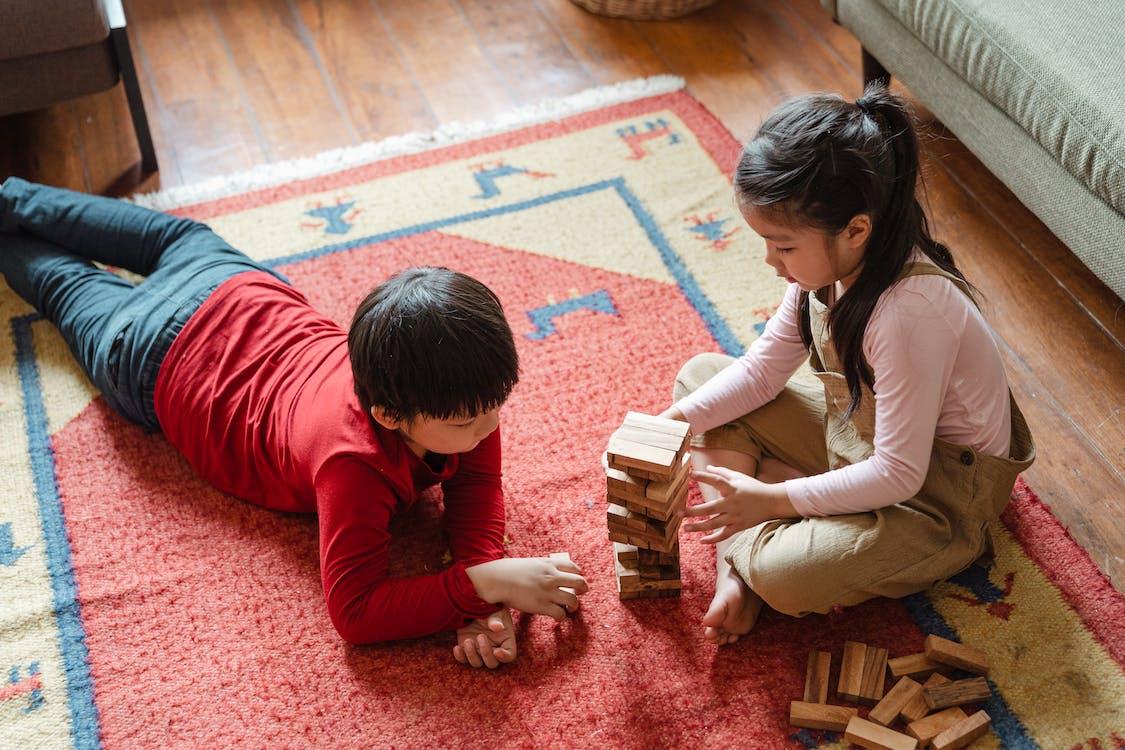Photo of Two Kids Playing Jenga