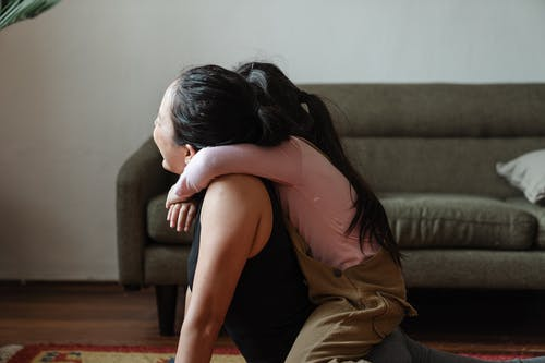 Photo of Girl Hugging Her Mom
