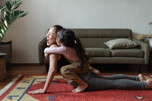 Photo of Girl Hugging a Woman While Doing Yoga Pose
