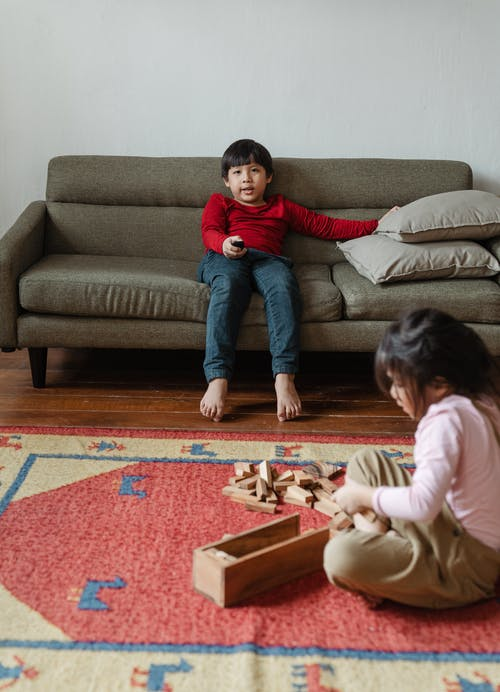 Content Asian children during spare time at home