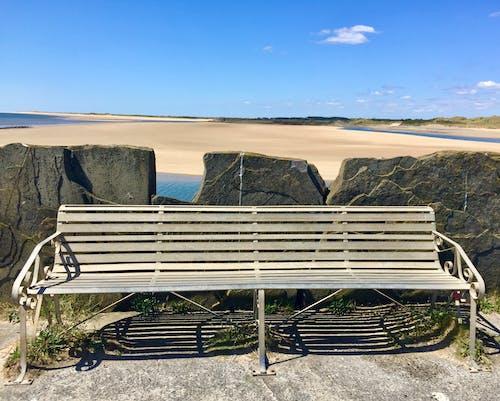 Free stock photo of beach, bench, blue sea
