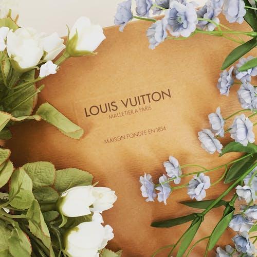 A Louis Vuitton Box near the Flowers