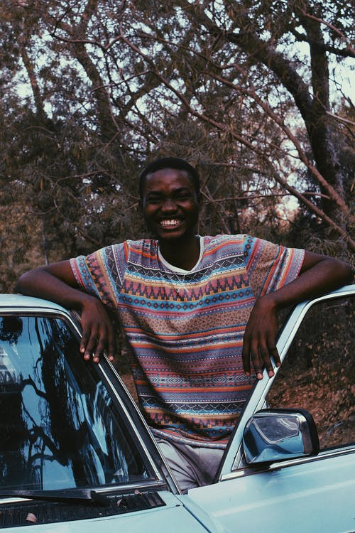Photo of Man Standing Near Car While Smiling