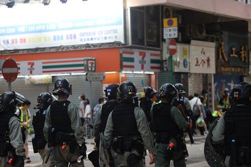 Crowd of police walking on street