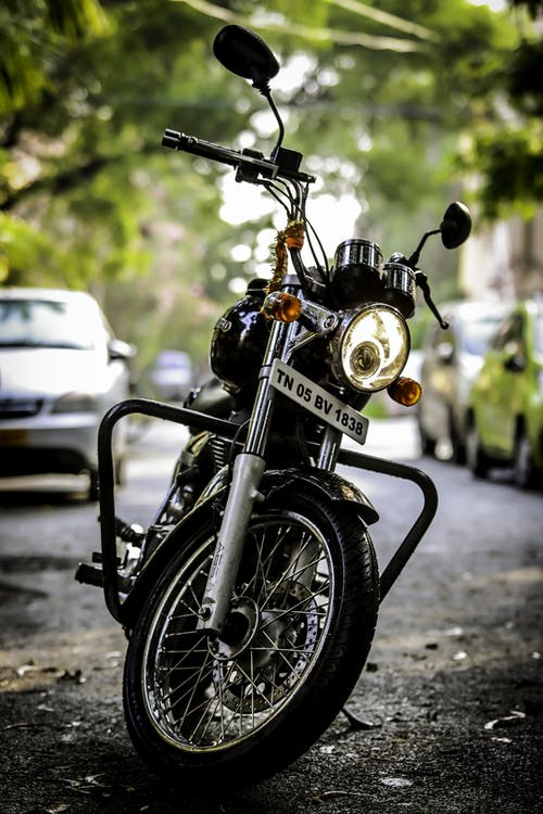 Black and Silver Cruiser Motorcycle Parked on Gray Concrete Road