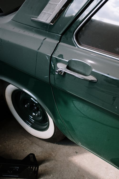 Green Car on Brown Floor